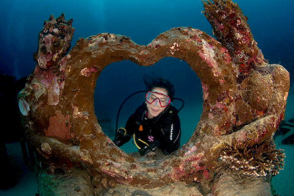 Years later, the Love Mermaid still draws marine enthusiasts as well as coral and fish. Courtesy: Toar Pantouw