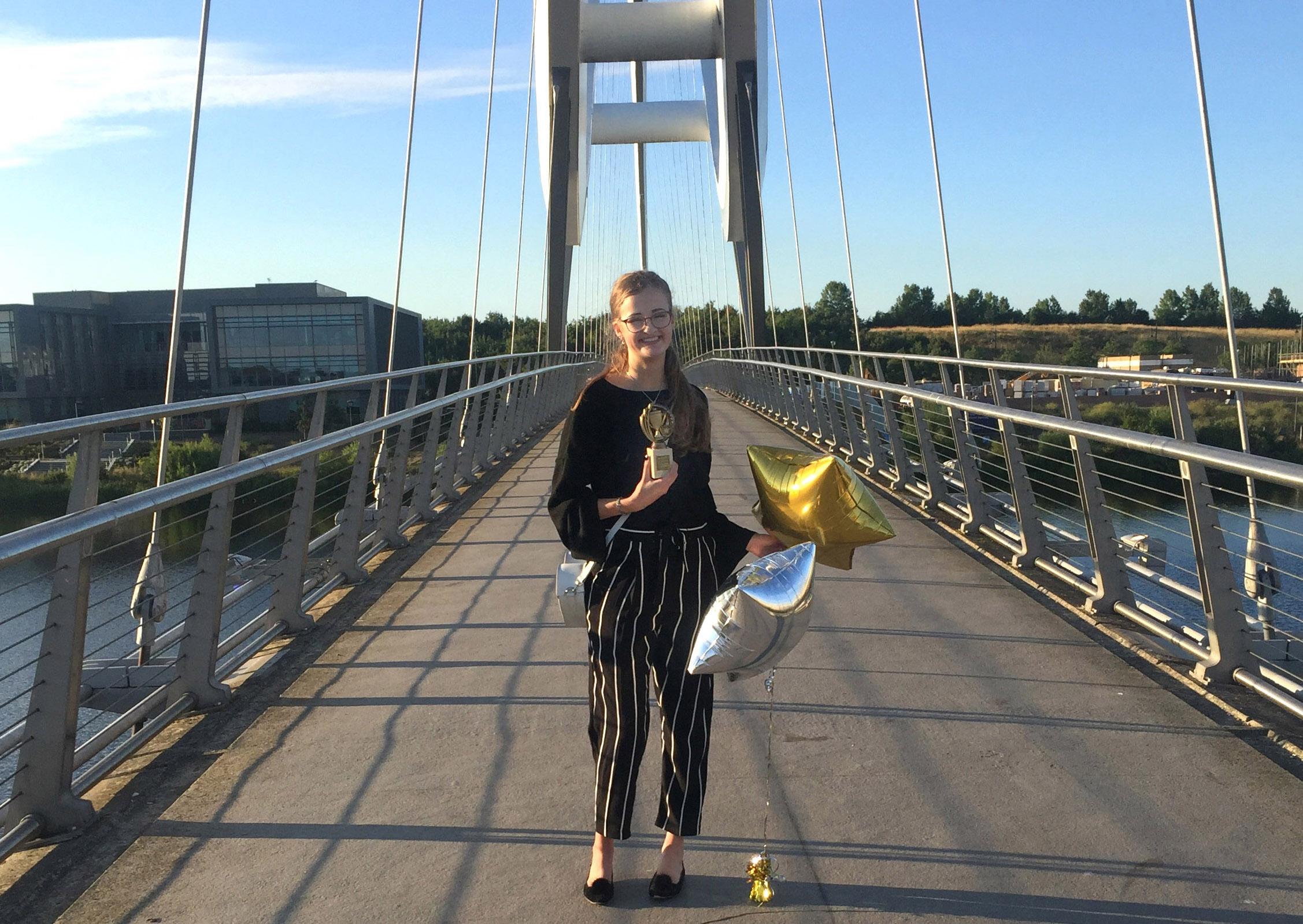 On Stockton Infinity bridge with Enterprising Stockton Award for 'Journey Travelled'