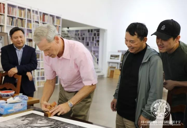 Mr. Steven C. Rockefeller Jr. signed and stamped on his photography work to Mr. Jiang Guofang