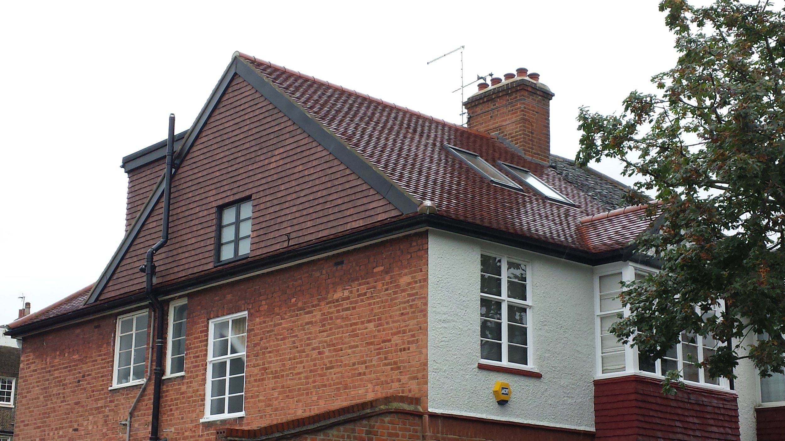 Hip to Gable in Clay roof tiles.jpg