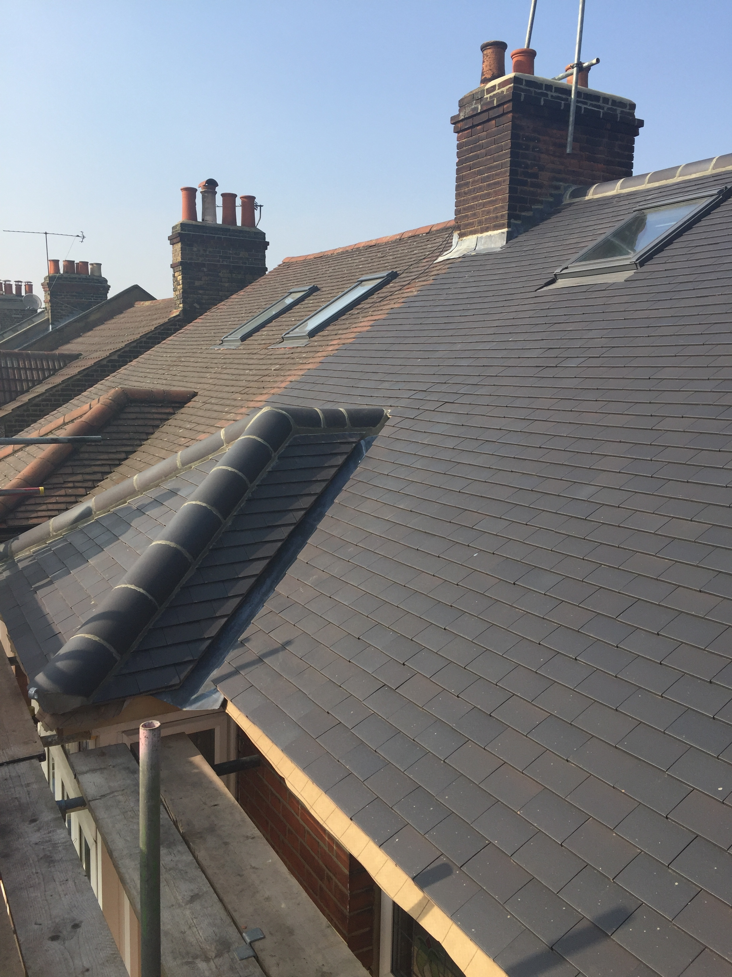 Re-roof in Clay Rood tiles.JPG