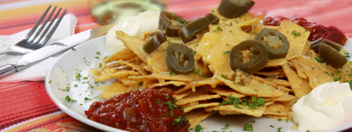 NACHOS - MEXICAN STYLE with melted cheese, jalapenos, sour cream & salsaLOADED our Mexican style above topped with spicy chicken or beef chilli