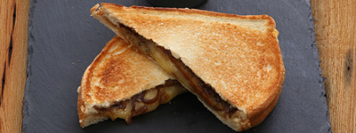 TOASTIES - Available in white, brown or gluten free bread*Cheese & Tomato (or onion) made with mild  cheddar*Ham & Cheese with Cotswolds ham & mild  cheddar*Tuna Melt with mayo & melted Welsh cheddar Sausage with red onion chutney