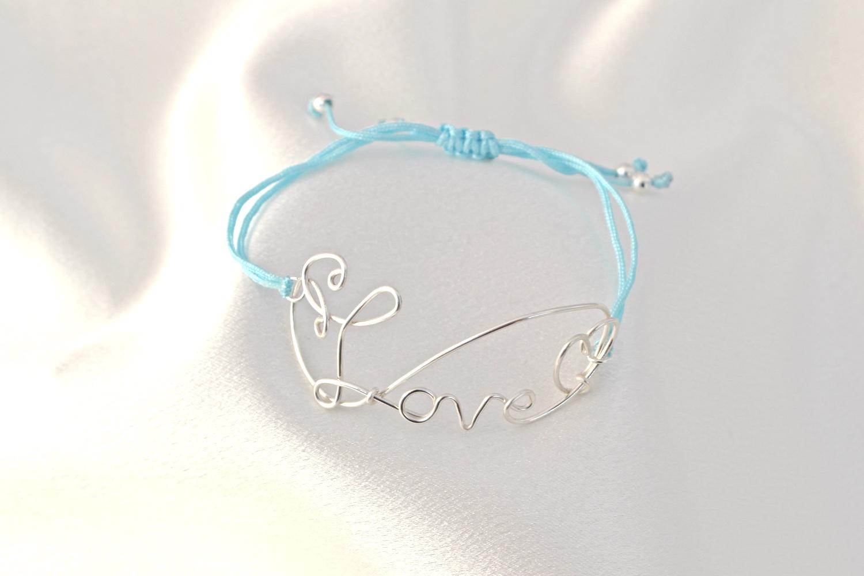 blue cord love braclete.jpg