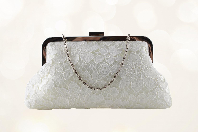 bridal bag in raised floral ivory lace.jpg