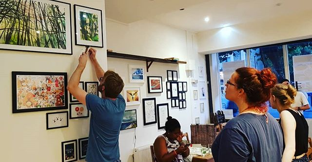 The Guys setting up their art for the art exhibition on Thursday. 6pm - 9pm. Make it down if you can !!!!! #NewRootsCafe #Art #ArtExhibition #KC #Cool #Islington