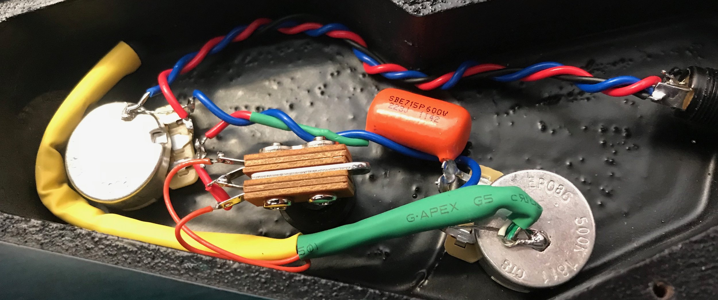 Neat wiring that works   From a simple restring and setup to a whole guitar overhaul, we can cater to most of your needs, in store, at a sensible price.    Please call us on 0430498051 for a quote to service or repair your guitar or simply drop in with your guitar for a chat.    Adam Harrison