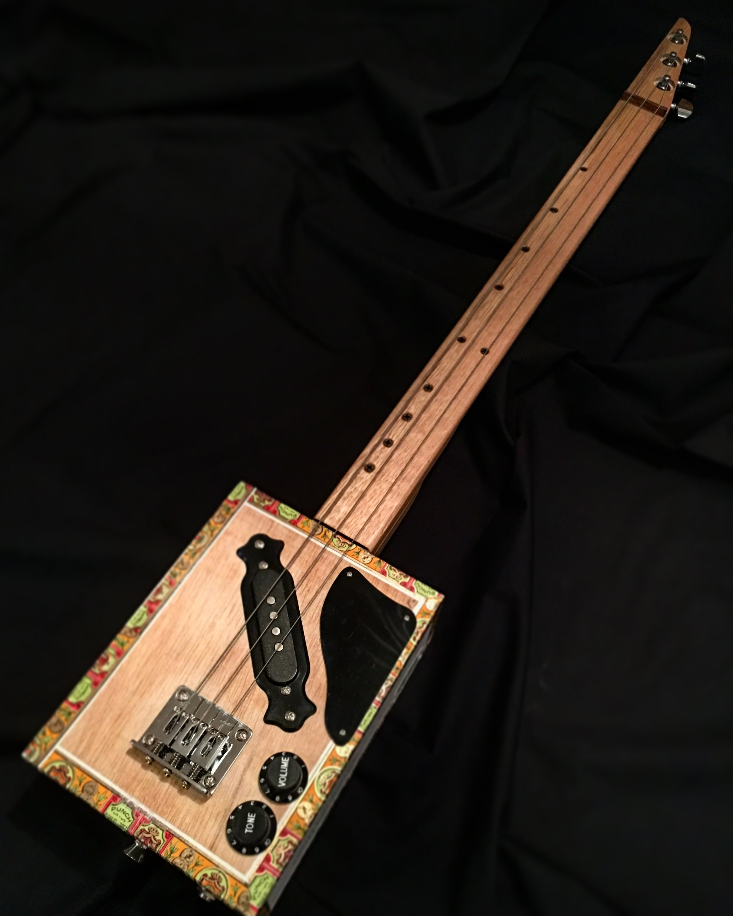 ROLLING THUNDER premium fretless CBG - The ROLLING THUNDER CBG is a quality fretless CBG with electric guitar pickup. They are designed for the musician who wants a quality instrument for stage use.These are a fretless instrument and will require a finger slide.They are made using a variety of great cigar boxes and are all unique.* genuine cigar boxes* mountain ash necks* Meranti or oak fingerboards for extra strength* electric guitar pickups* fixed steel bridge* quality tuners* industry standard electrics* decorative corner protectorsFrom $329