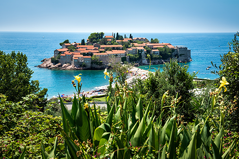 Aman Sveti Stefan, Montenegro - Serene sea views and cobbled lanes characterize the tiny islet of Sveti Stefan. Attached to the coast by a narrow isthmus, this once fortified fishing village dates back to the 15th century and has undergone incredibly detailed restoration. It is now home to Aman Sveti Stefan.