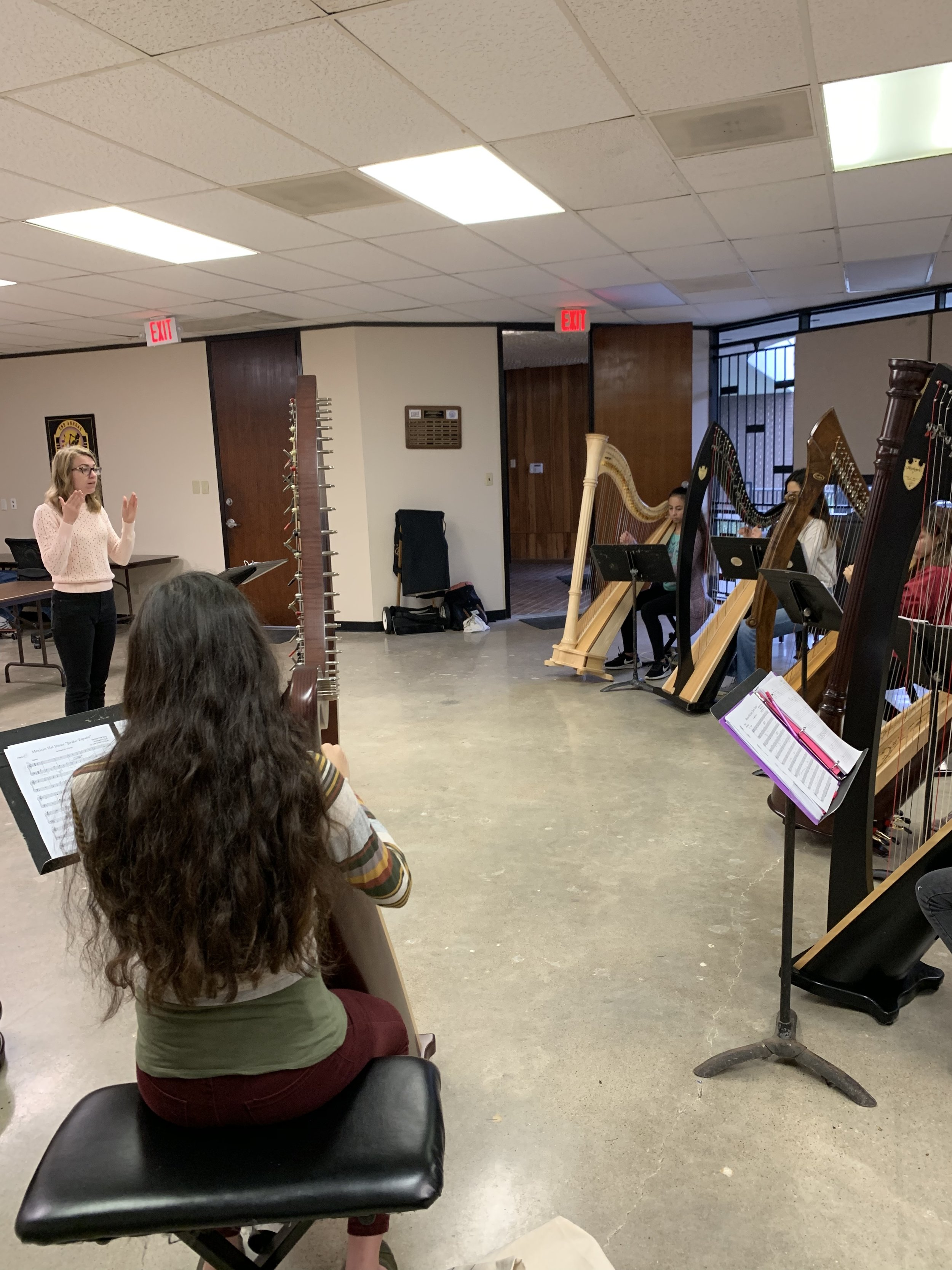 Stephanie conducting the Houston Youth Harp Ensemble