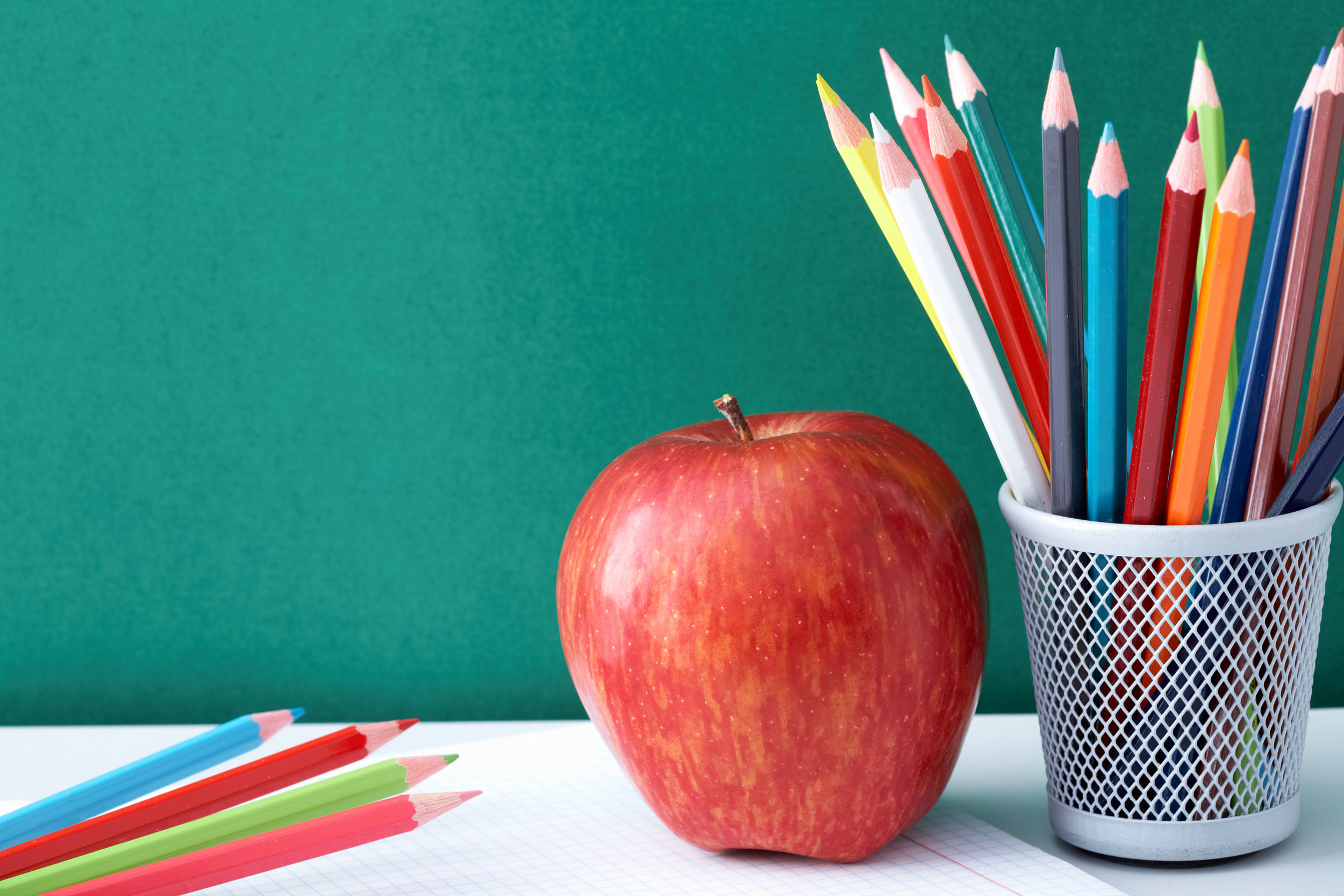 graphicstock-image-of-crayons-and-red-apple-against-blackboard_HaQHZBR14b.jpg