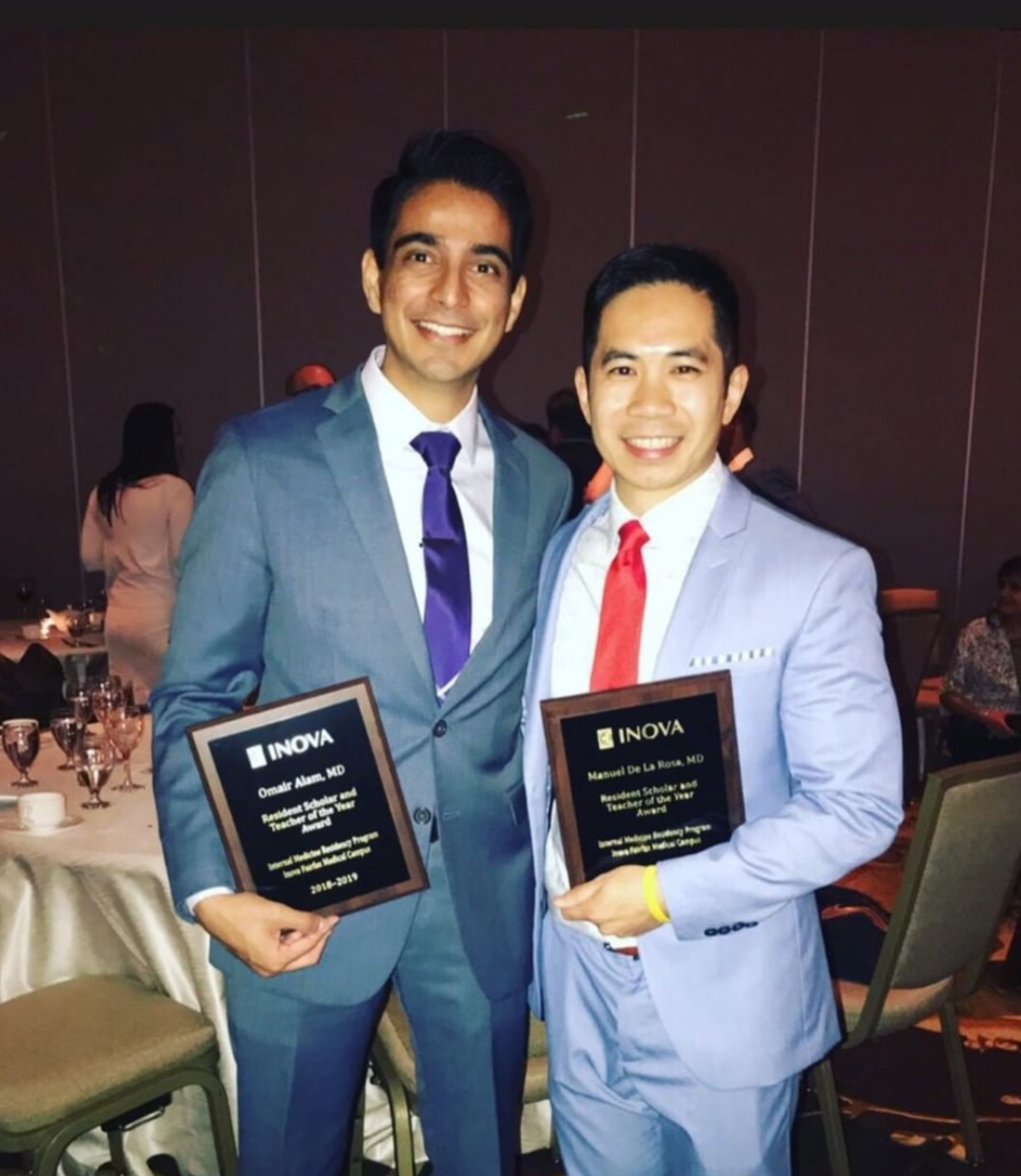 "Photo provided by Manny De La Rosa / ""This is from my residency graduation banquet. My colleague and I shared the award for Resident Scholar and Teacher of the Year."""