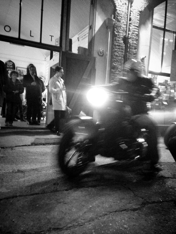 Bike being ridden outside Bold Motorcycles London.