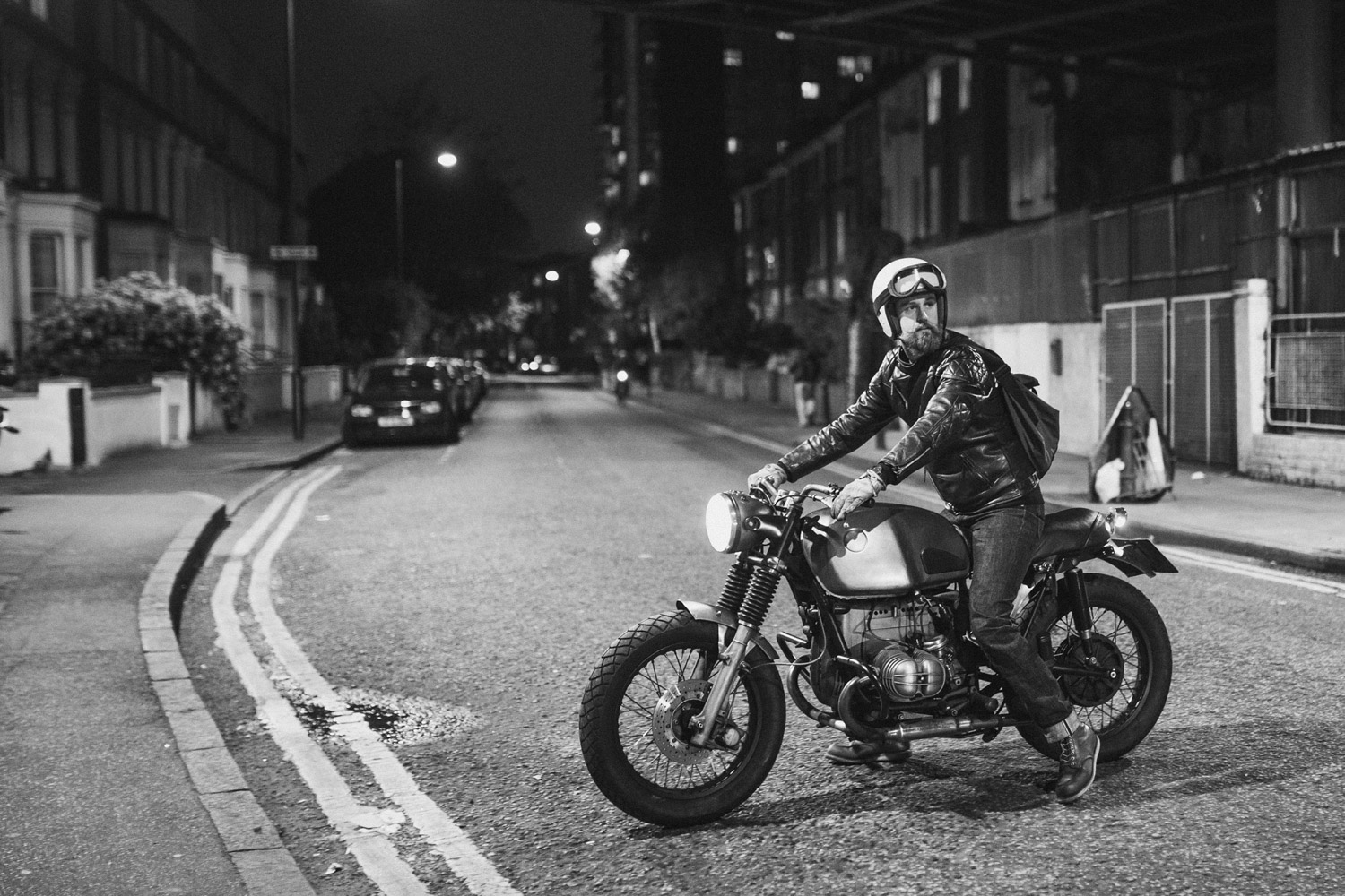 Motorcycle being ridden outside Bolt Motorcycles London.
