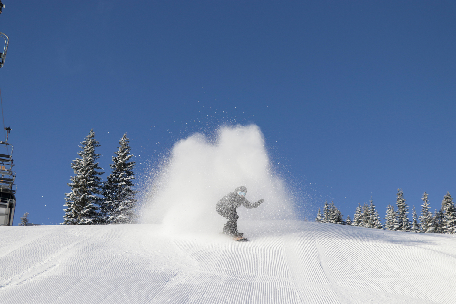 Jeff Caven ripping through his own cloud on a cold morning in February.