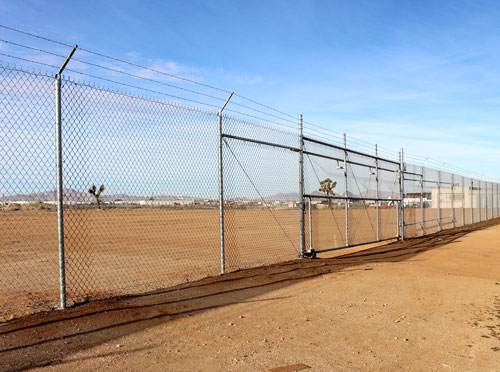 COMMERCIAL CHAIN LINK - From commercial construction jobs to large scale military projects, Marriott Fence Construction can handle the job. We install all types of commercial chain link and metal fencing including crash rated fencing and barriers.