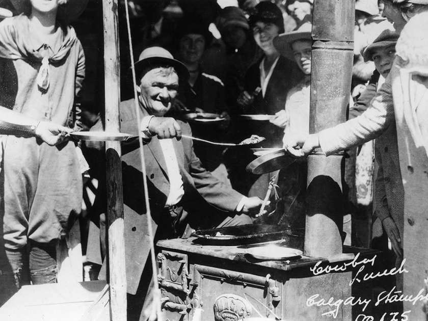 JULY 1923 - Horace Inkster, serving pancakes at Calgary Stampede street breakfast. from the Jack Morton wagon. Inkster was cook on Morton's CX Ranch.COURTESY GLENBOW ARCHIVE