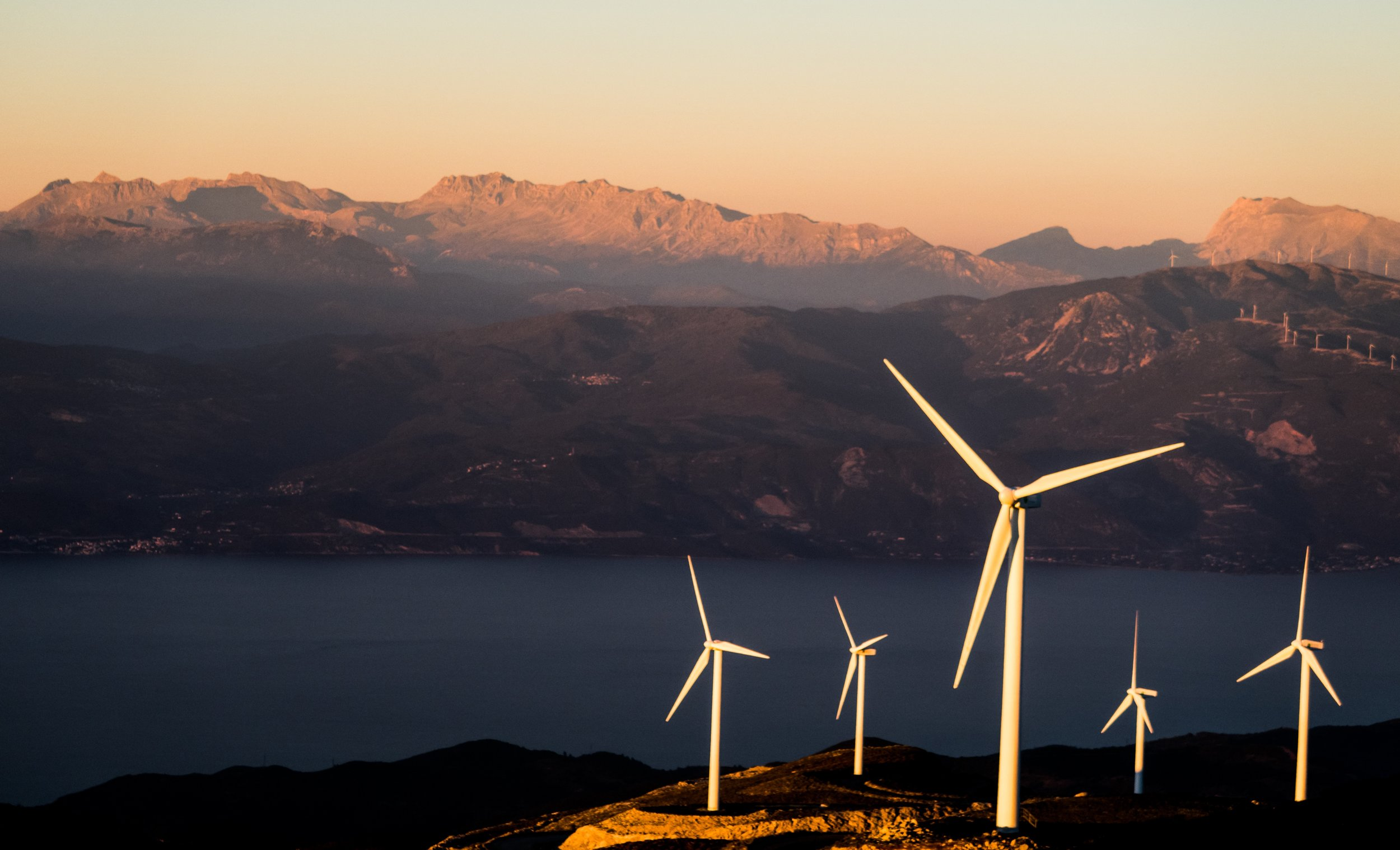 windturbines-cliff-mountains-water.jpg