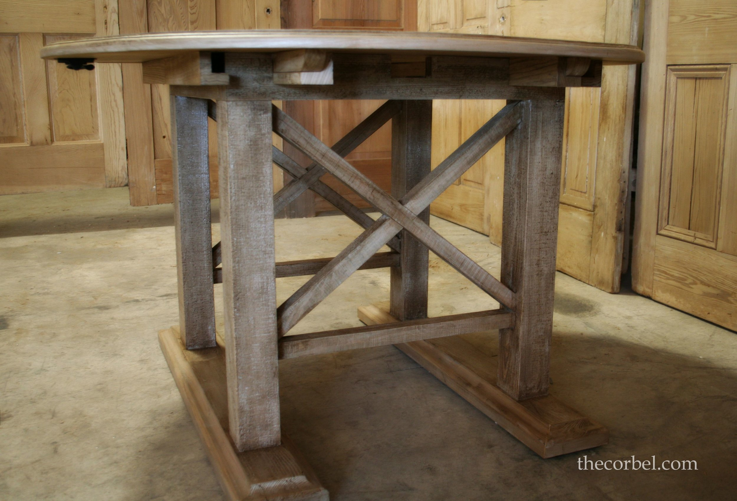 Round leaf table with x design natural finish WM.jpg