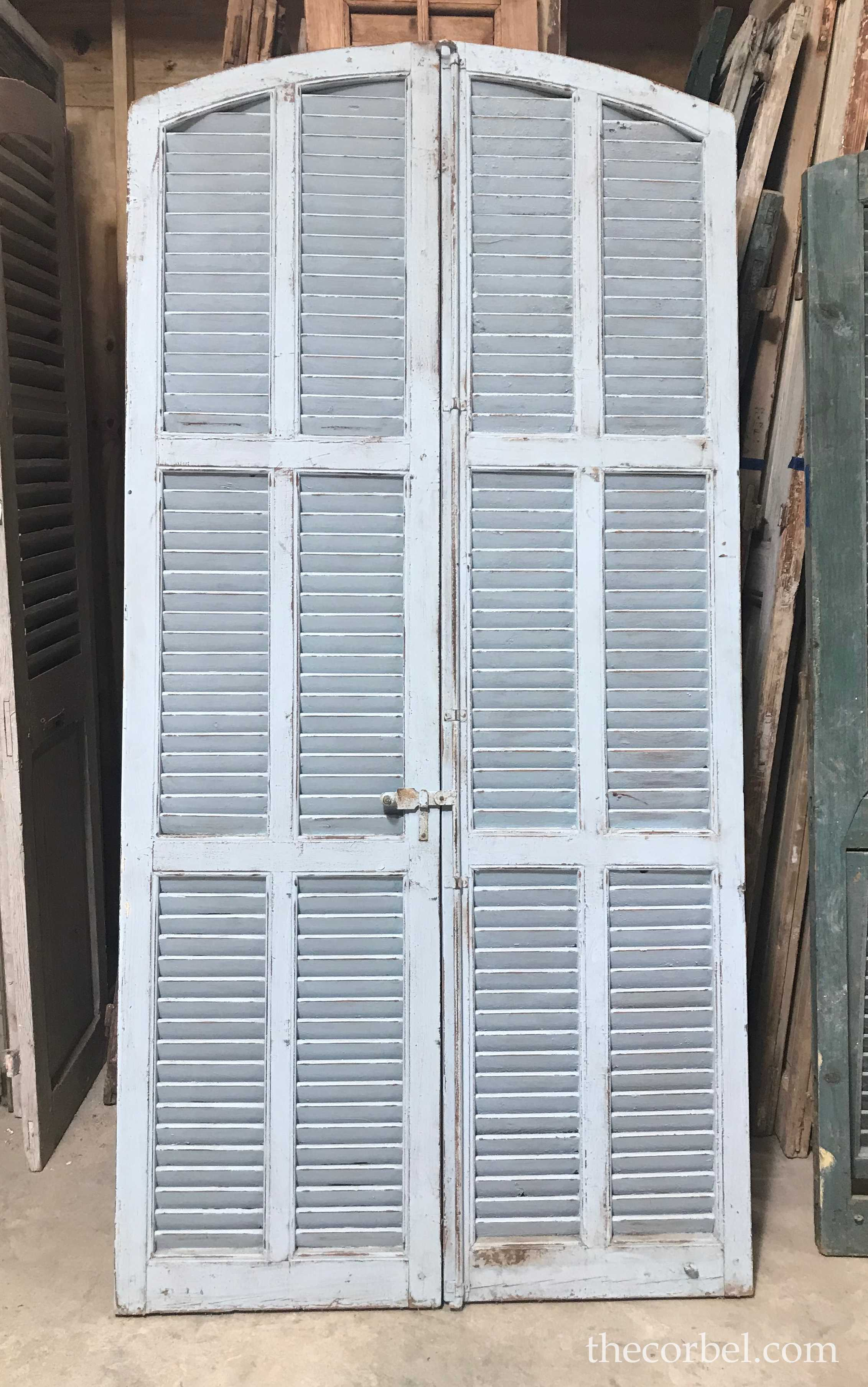 the corbel antique arched shutters.jpg
