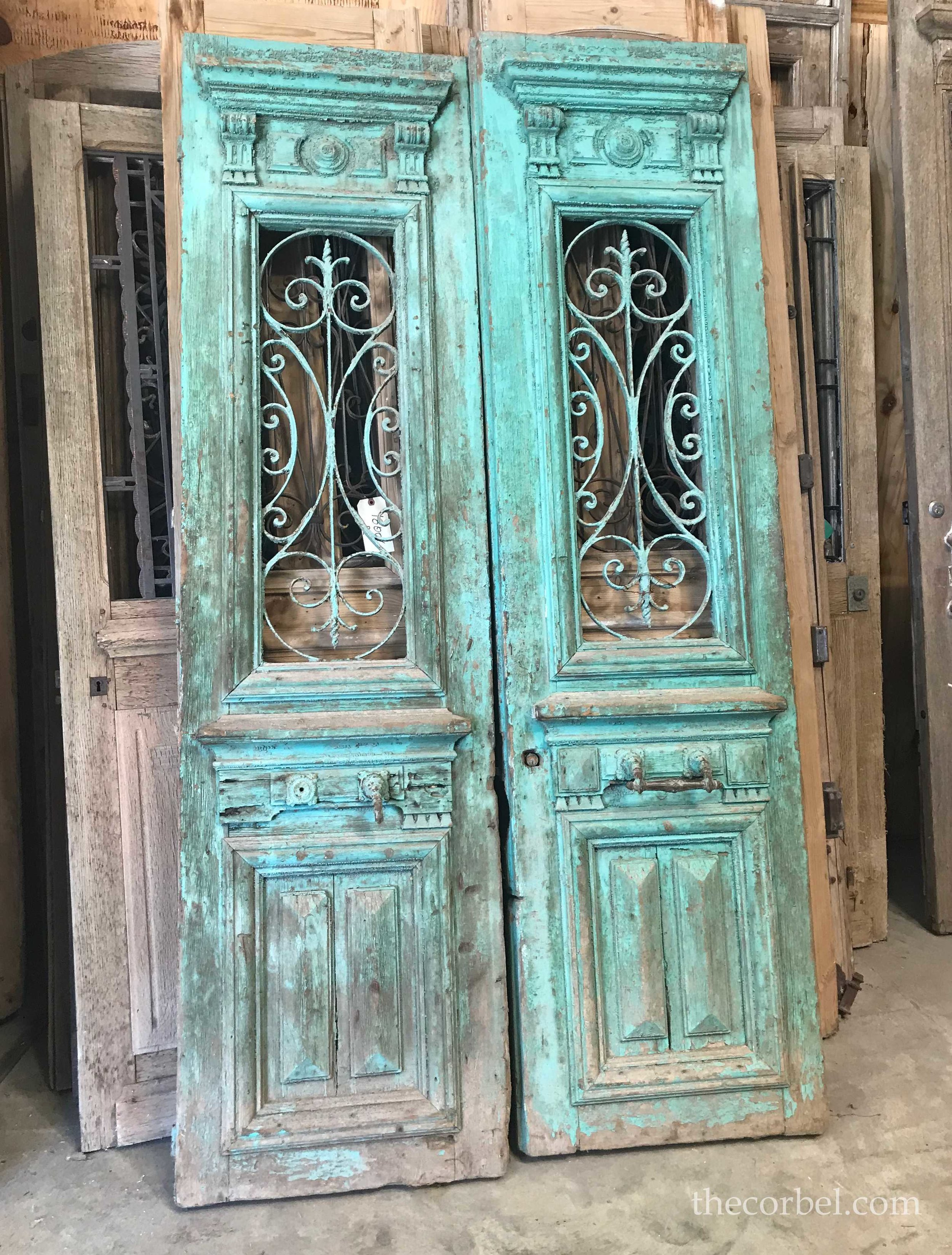 the corbel antique iron doors teal.jpg