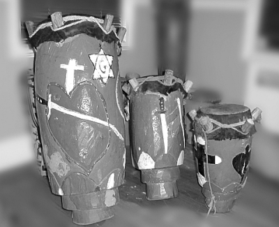 Rada drums from Jacmel, Haiti (Tanbou Lafrik Ginèn) Carved wood covered with cow-skin attached with pegs. (left to right) Manman, Segon, Boula.