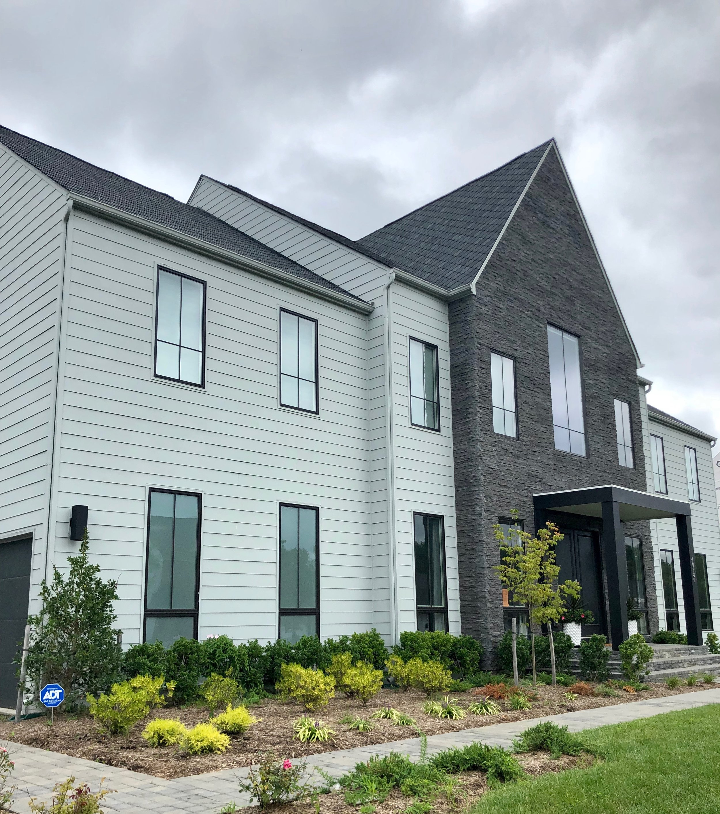 - From the day I laid eyes on this custom new build exterior I was smitten! Once I entered the space, I was enamored even more and set to work on a design that would highlight the architecture, clean lines and soaring ceilings but also leave this young family with a cozy place to kick back.