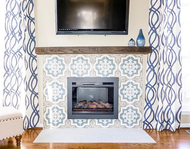 #TBT to when we updated this builder grade fireplace with penny tile, a patterned tile surround and reclaimed wood mantle. #givemeallthepatterns . . . . #interiordesign #interiordesigner #interiors #homedesign #homedecor #syling #artwork #paint #decoration #renovation #design