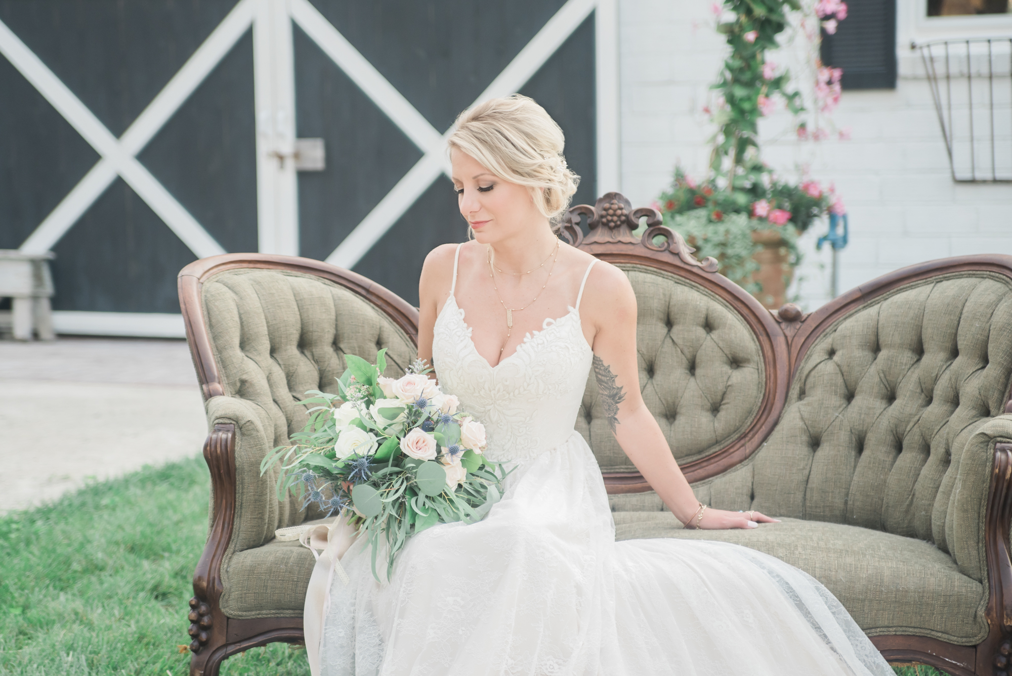 Our lovely model, Nicole Oidman, poses with her bouquet created by Diana Fox at Allen's Flowers.
