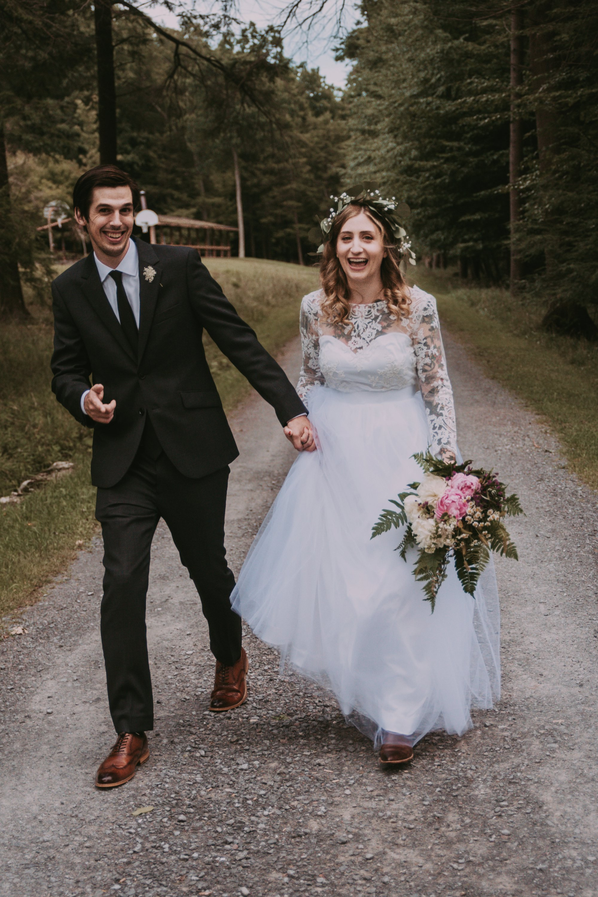Rustic Intimate Vegan Forest Wedding with Handmade Dress. Couple Laughing.