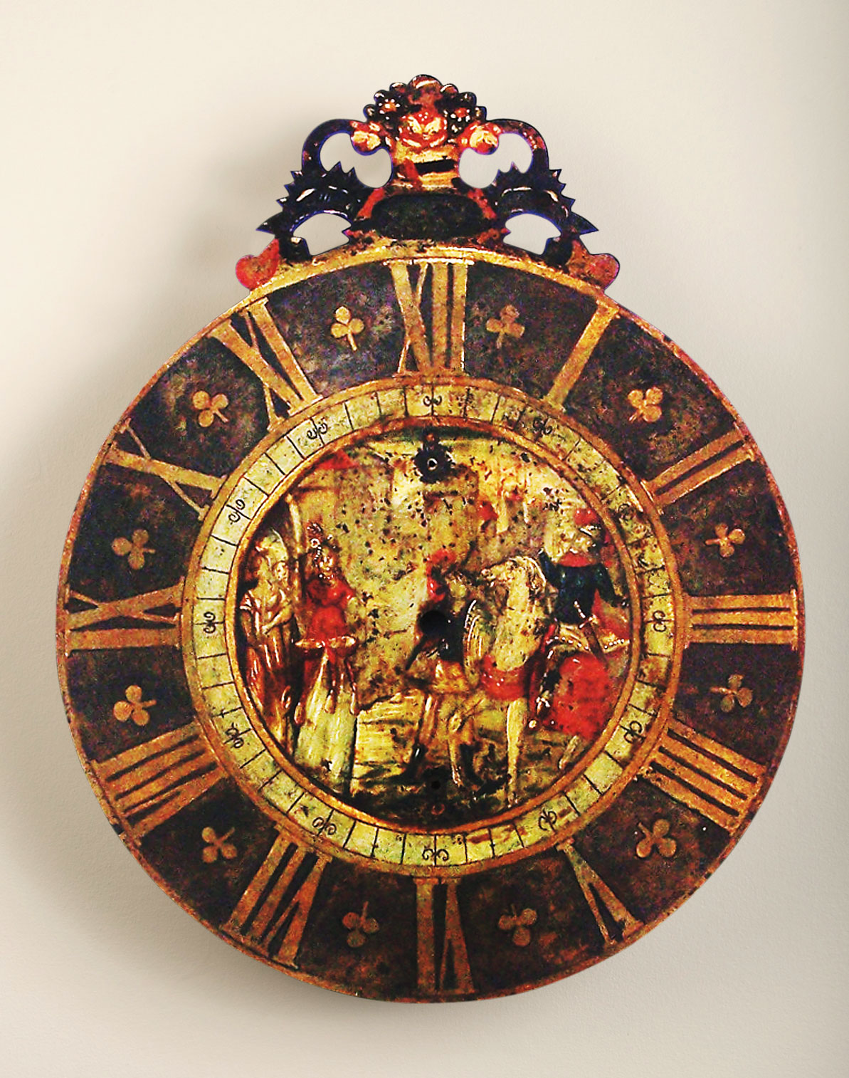 Dial of a clock made ca. 1800, depicting the story of Jephtha (found in Judges 11:20–40). This clock would have been a reminder to Mennonites to not swear oaths. Background photo: Mandtler clock made in 1899, depicting the story of Hezekiah (found in 2Kings 19:9–14). Courtesy of the Kauffman Museum.