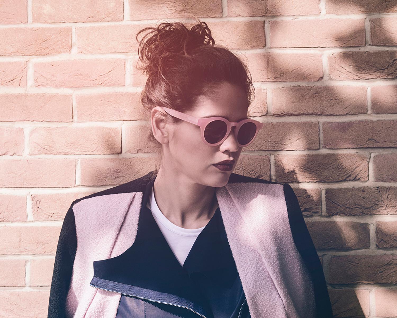 portrait photographer Tim Cole shoots girl against brick wall