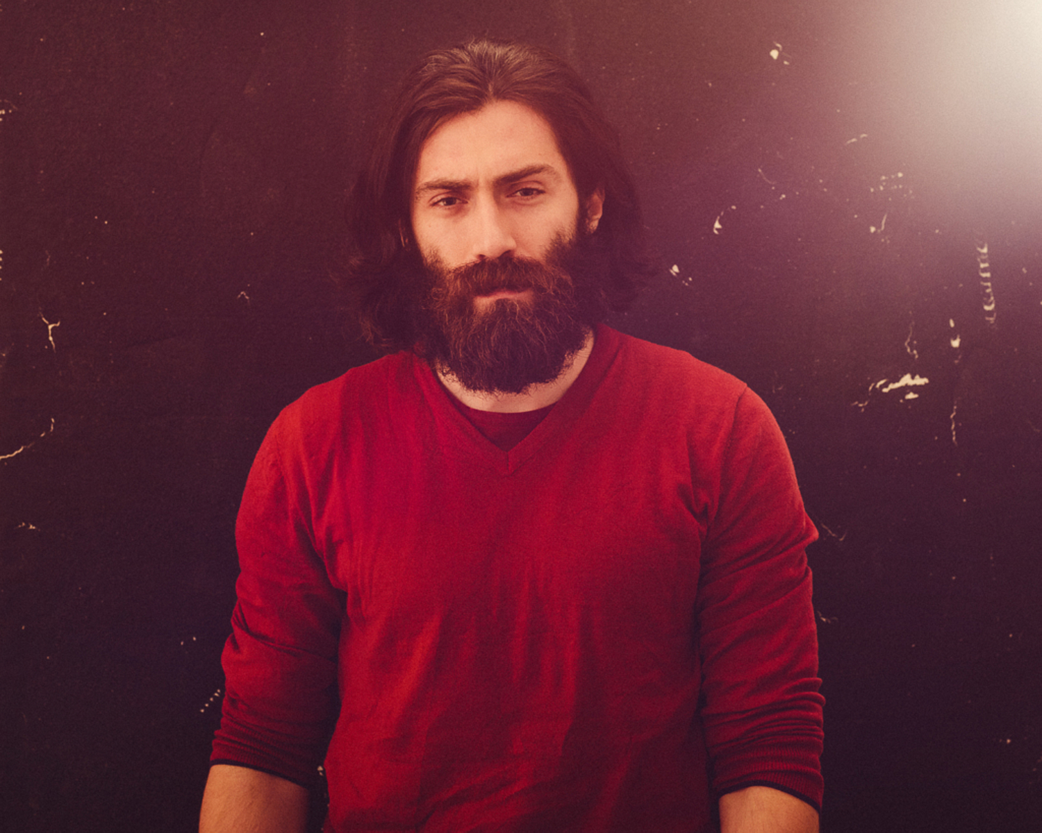 portrait photographer Tim Cole shoots man in red jumper