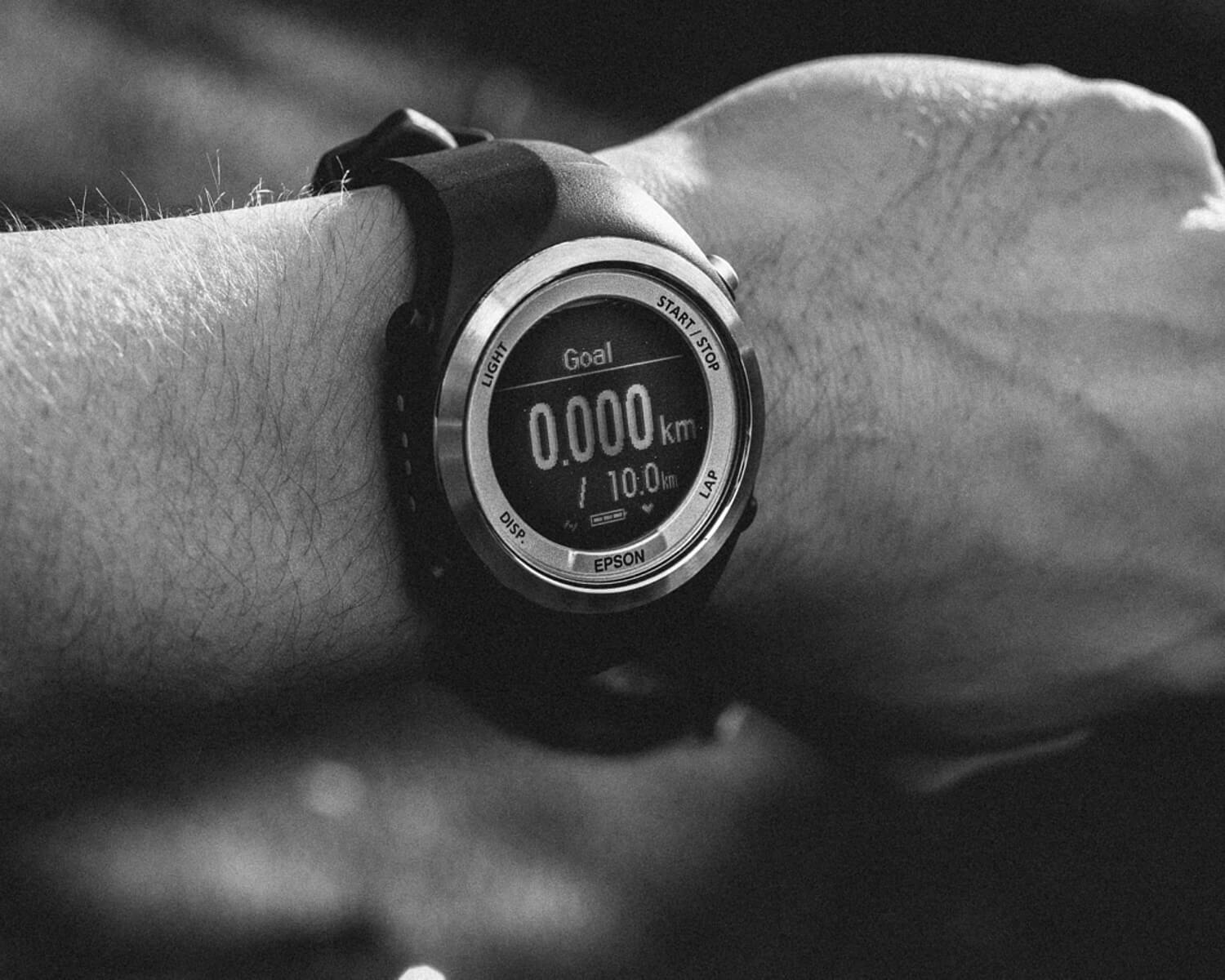 lifestyle photographer Tim Cole shoots runner looking at his watch