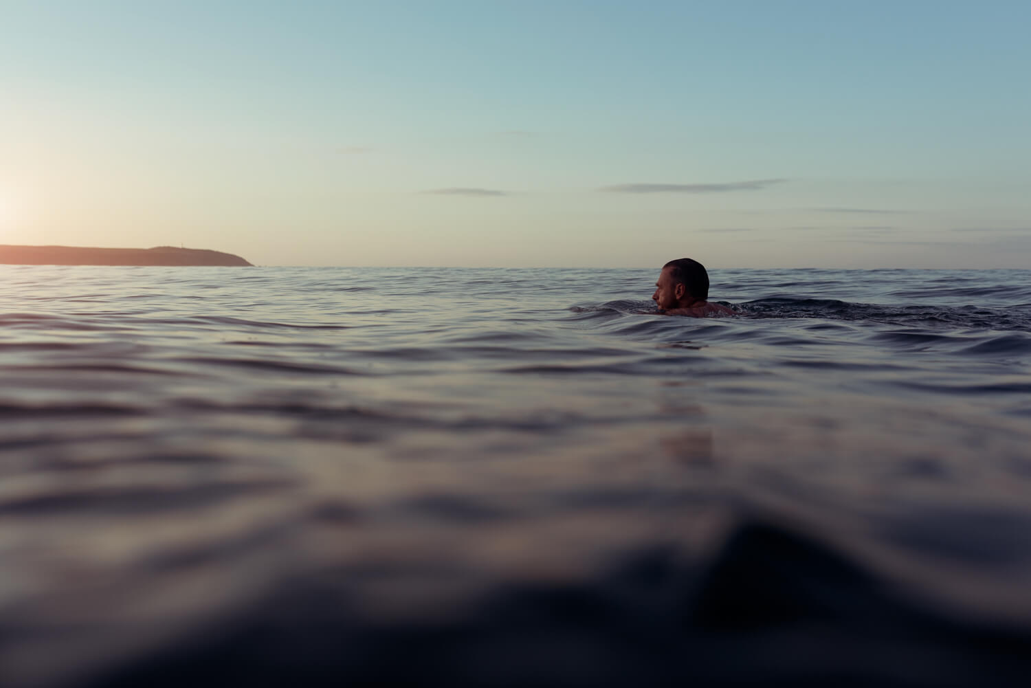 lifestyle photographer Tim Cole shoots morning swimmer out at sea