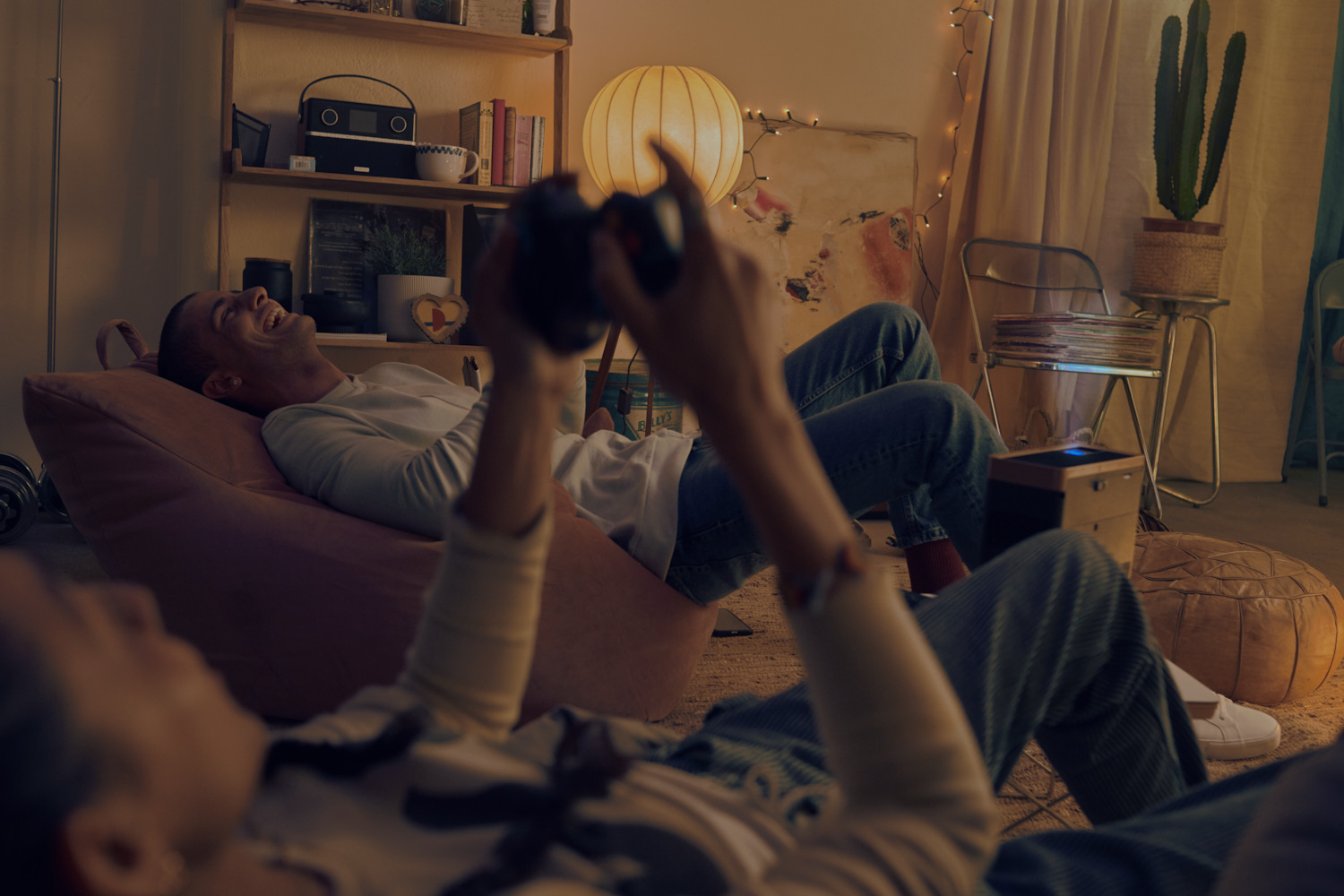 lifestyle photographer TIm Cole shoots two people enjoying playing video games