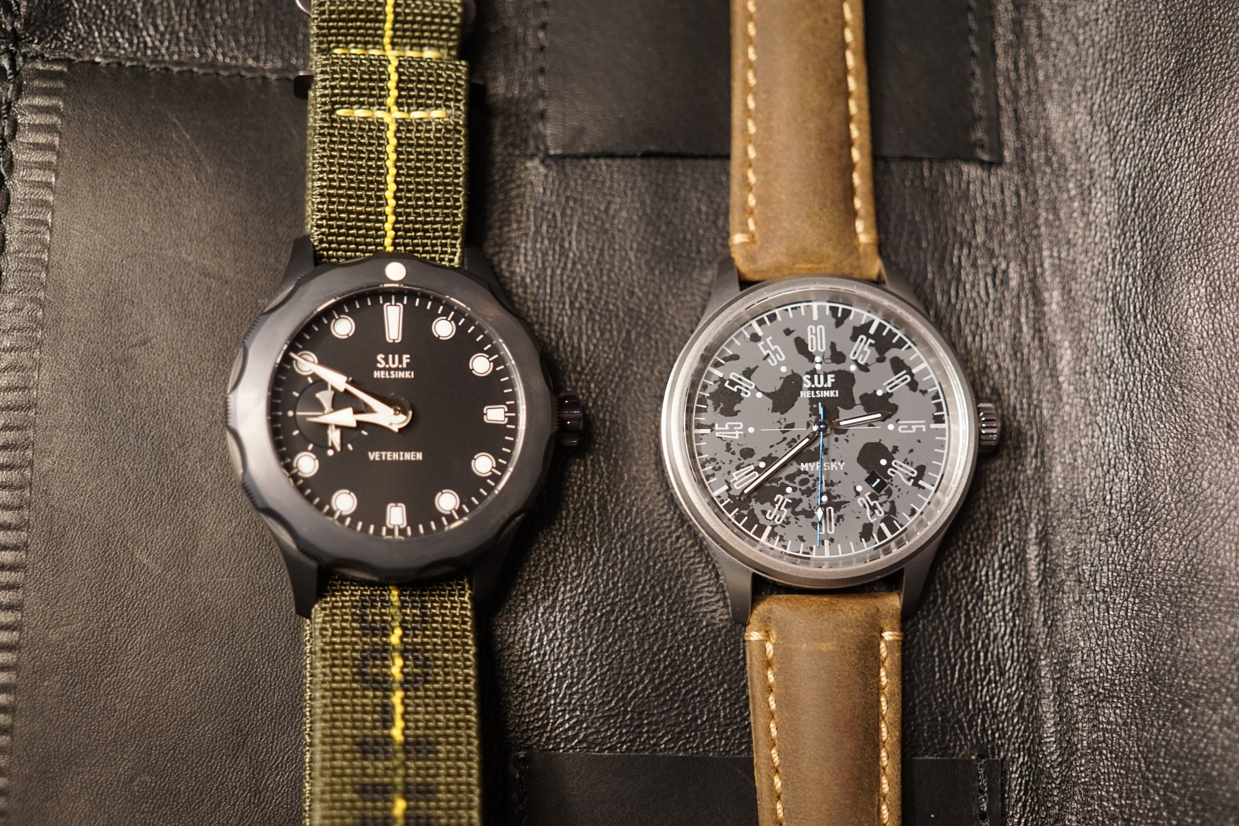 On the left the yet-to-be-released S.U.F. Vetehinen with a DLC coated case, and on the right a new S.U.F. collaboration with Makia, the Myrsky Archipelago.