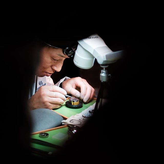 One of the ten Master Watchmakers of Grand Seiko showcasing what goes into assembling a spring drive movement at The Watch Show Finland.