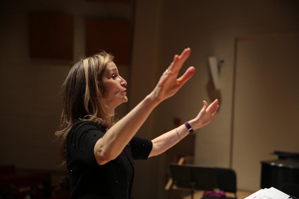 Jeanne conducting.JPG