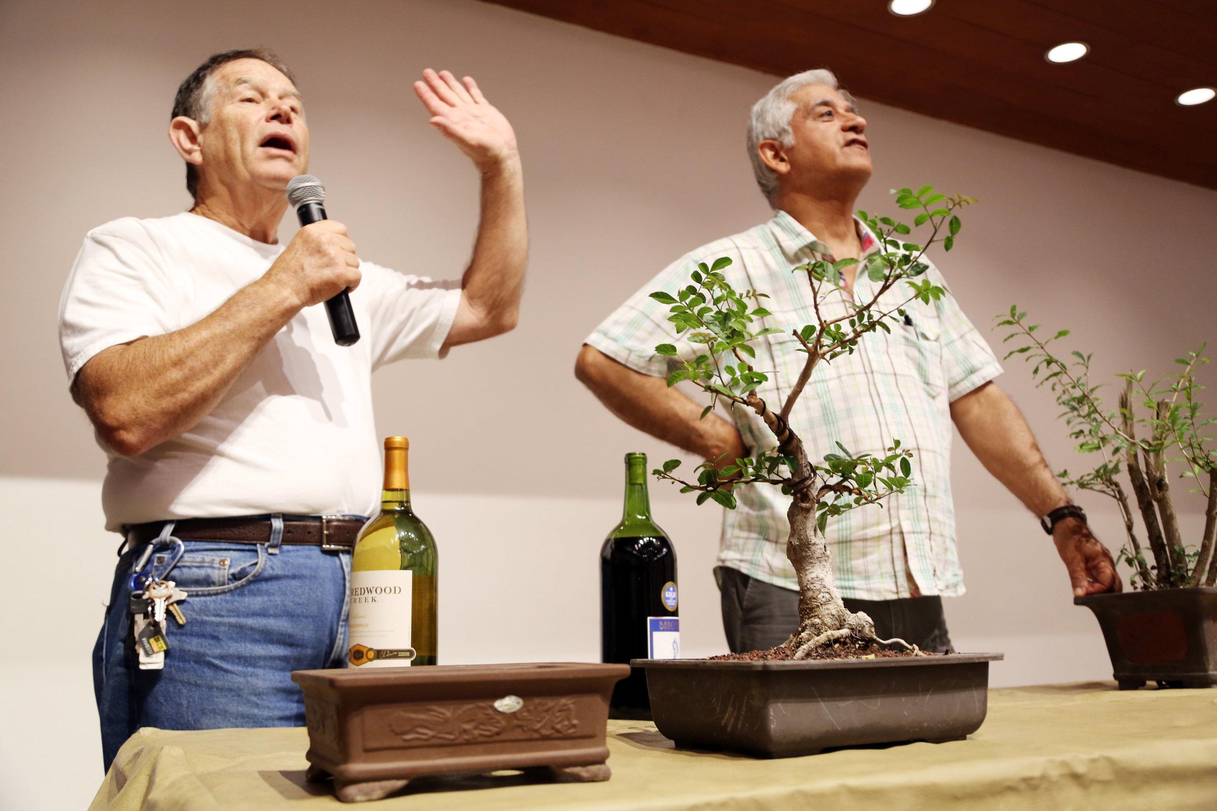 Michael-and-Cesareo-explain-the-auction-process.jpg