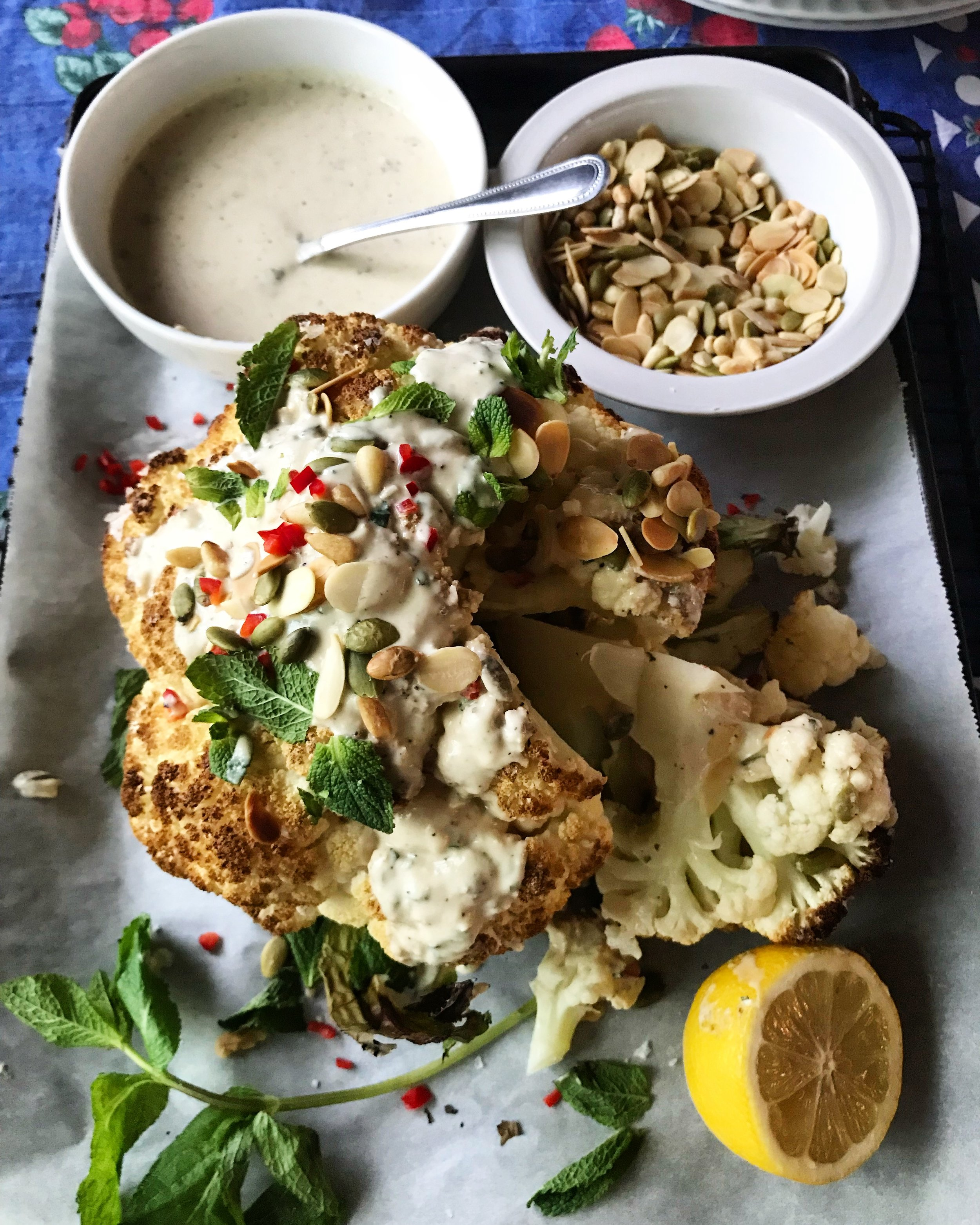 HERE IS WHAT YOU NEED: - 1 large head cauliflowerolive oilsaltpepperza'atar 1/2 cup good quality tahini1 large garlic clove, minced1 lemon - peel grated, juice squeezed1/4 cup water, or until tahini becomes smooth2 tablespoons chopped mintsunflower seeds, sliced almonds, pine nuts, sesame seeds (one kind or mix of few) - toasted