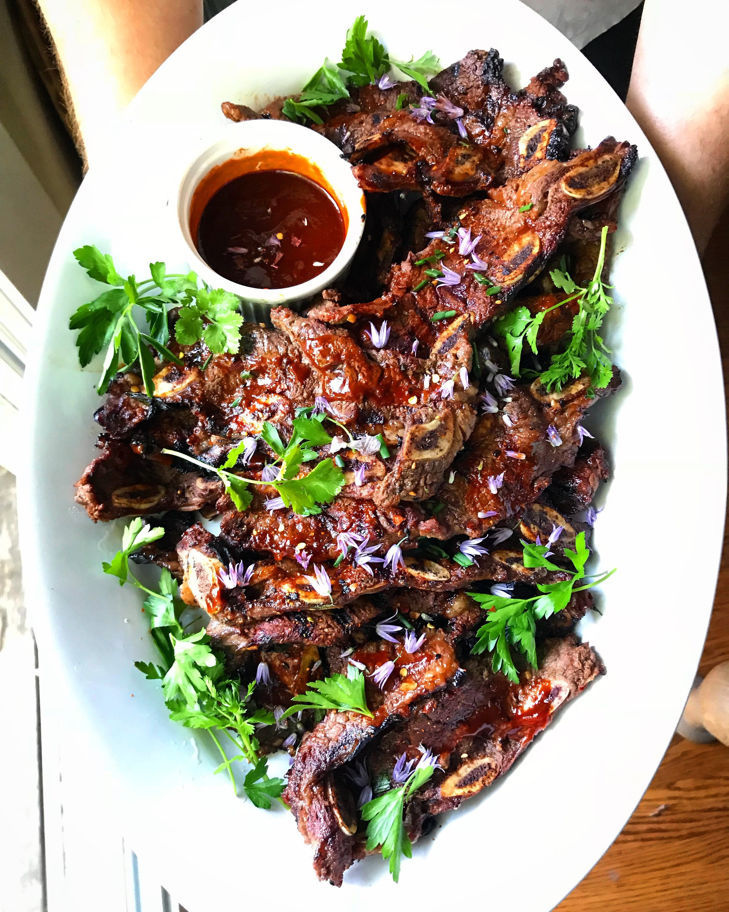 HERE IS WHAT YOU NEED: - 5 pounds Korean style short ribsFor the marinade:3/4 cup soy sauce (low sodium can be used)1/4 cup brown sugar1/4 cup rice wine (mirin)1/4 cup water2 tablespoons sesame oil3 large garlic cloves, minced2 tablespoons fresh ginger, minced1 tablespoon hoisin sauce1 teaspoon red pepper flakes (or to taste)2 green onions, sliced thinly2 tablespoons sesame seedsFor the asian style barbecue sauce:1/4 cup hoisin saice2 tablespoons rice vinegar1/4 cup sweet hot pepper sauce1 tablespoon sesame oil1/4 cup water