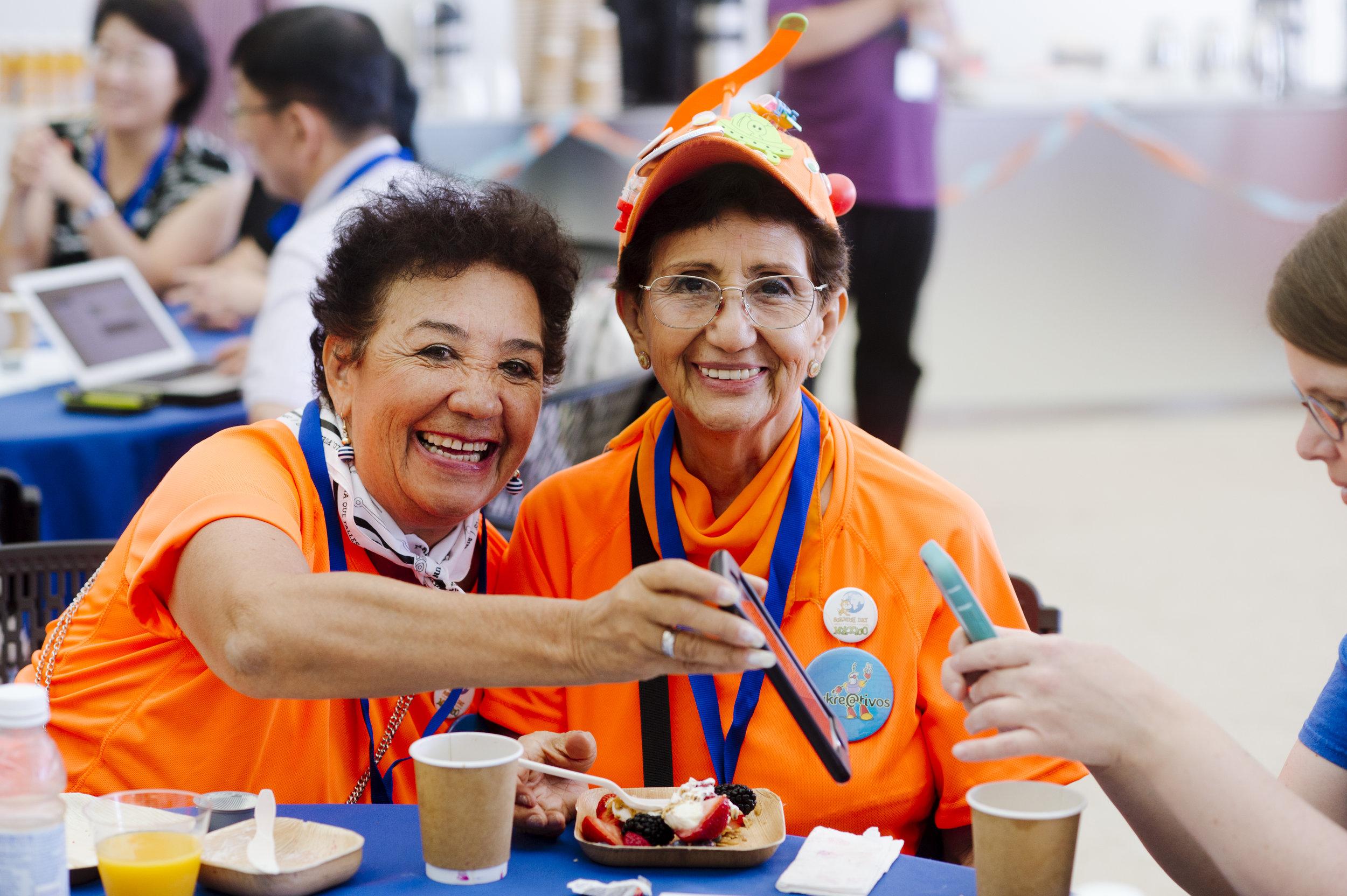 Women dressed in orange at Scratch Conf