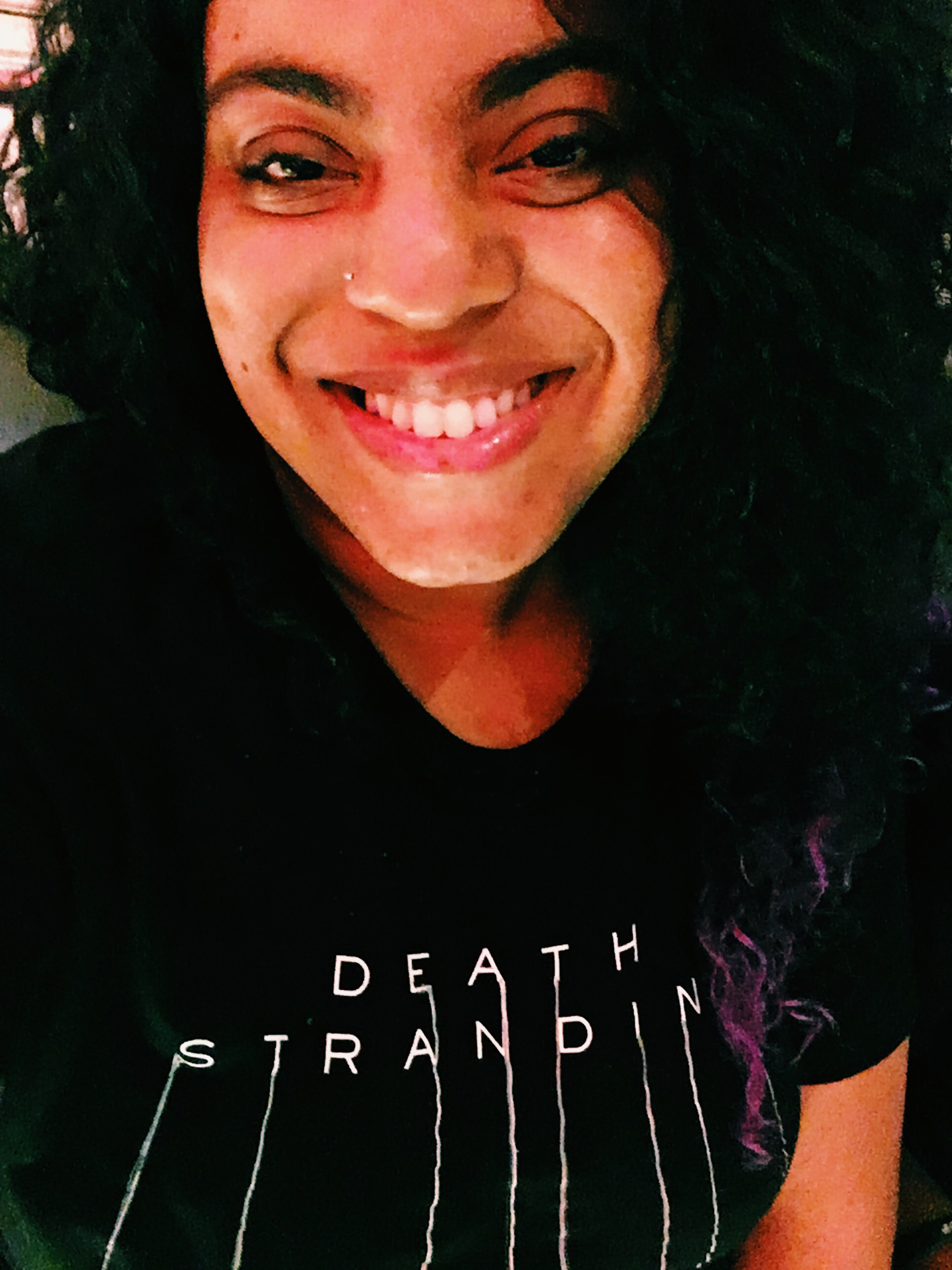 All smiles in a Death Stranding tee.