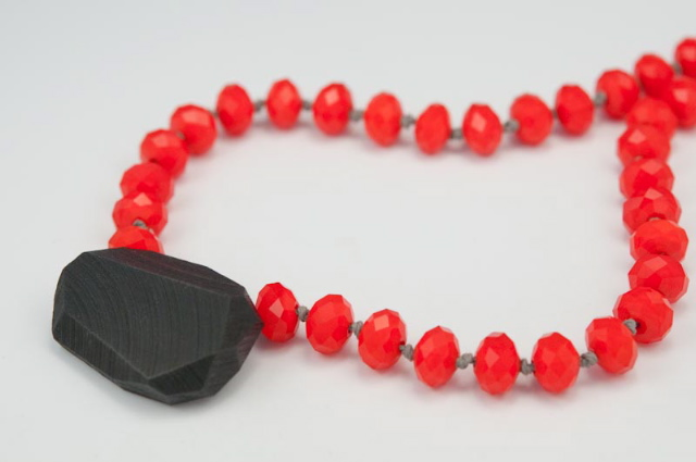 above necklace: Red Light Strand, faceted glass, wood, paint, steel