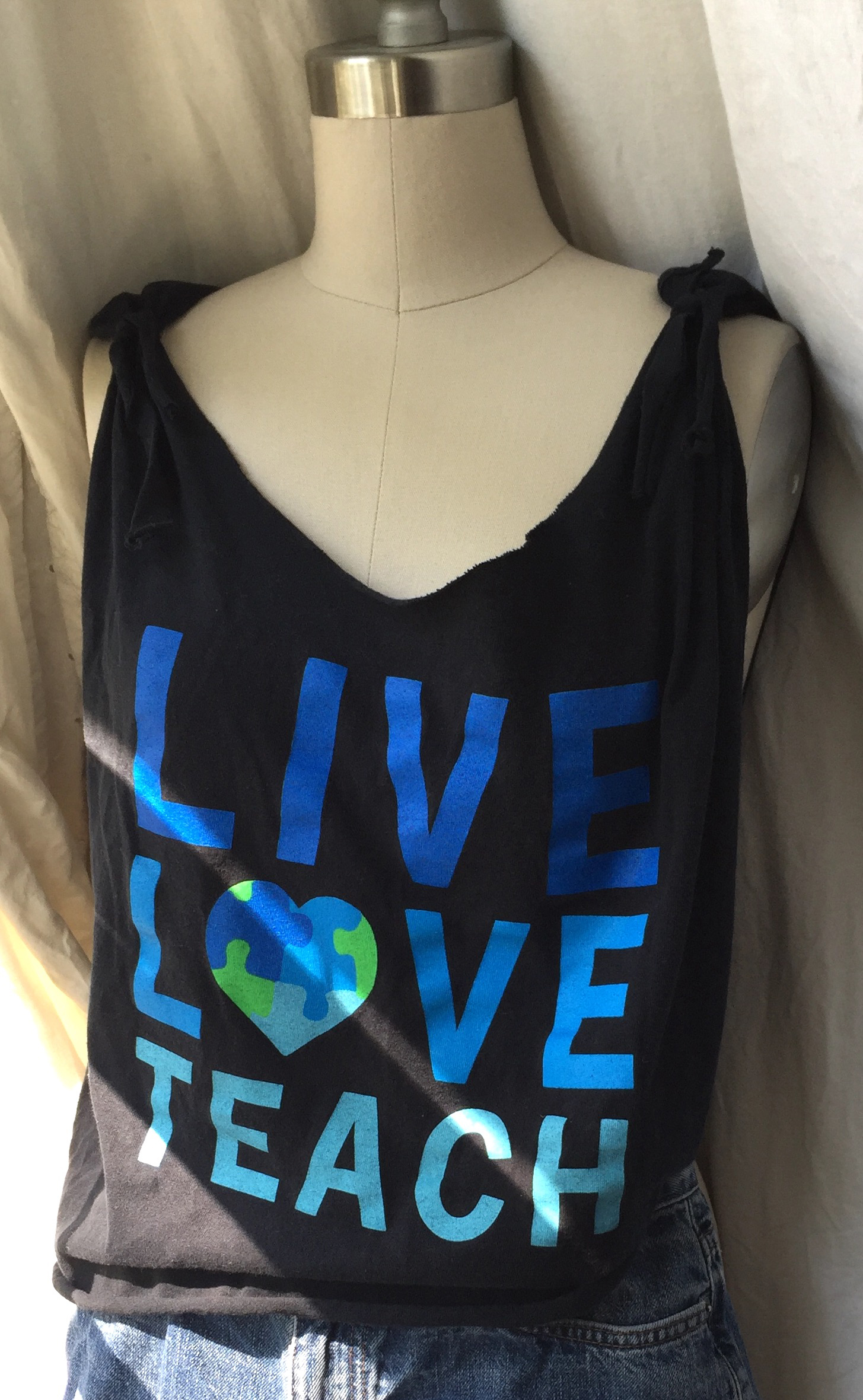 An attempt to repurpose an Autism Awareness X-Large t-shirt into a cute tank.