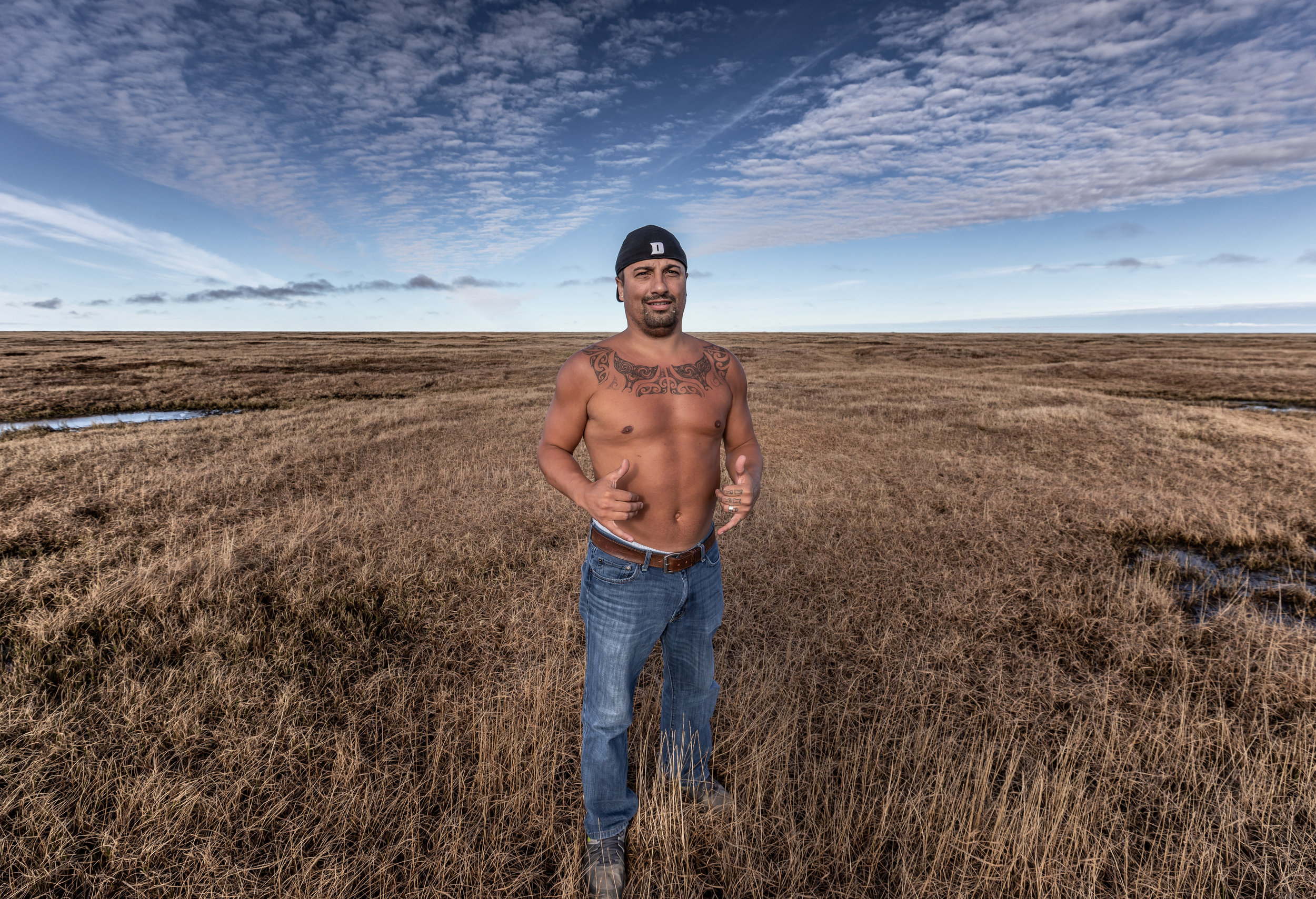 Qaiyaan Harcharek, an Iñupiaq whaler and resident of Utqiaġvik, stands on the Arctic Coastal Plain, the frontline of climate change.