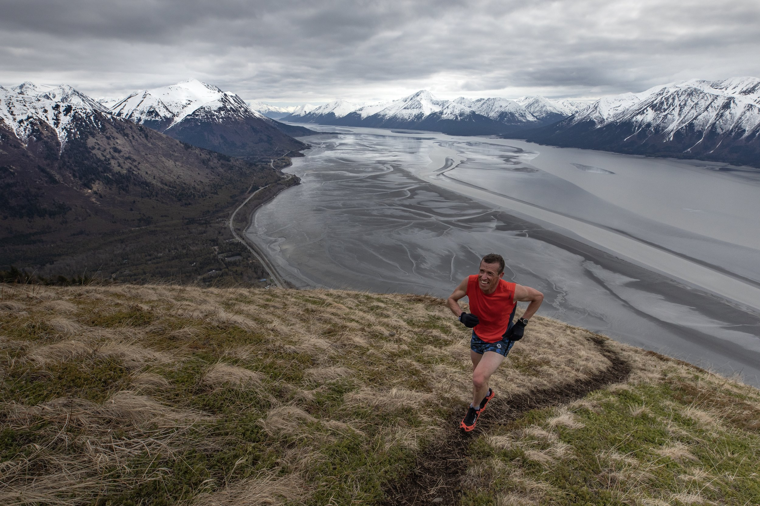 Alaskan endurance athlete Matt Novakovich trains on IndianHouse Peak. A relentless grade and an amazing backdrop, IndianHouse is a local test-piece for Anchorage based mountain athletes.