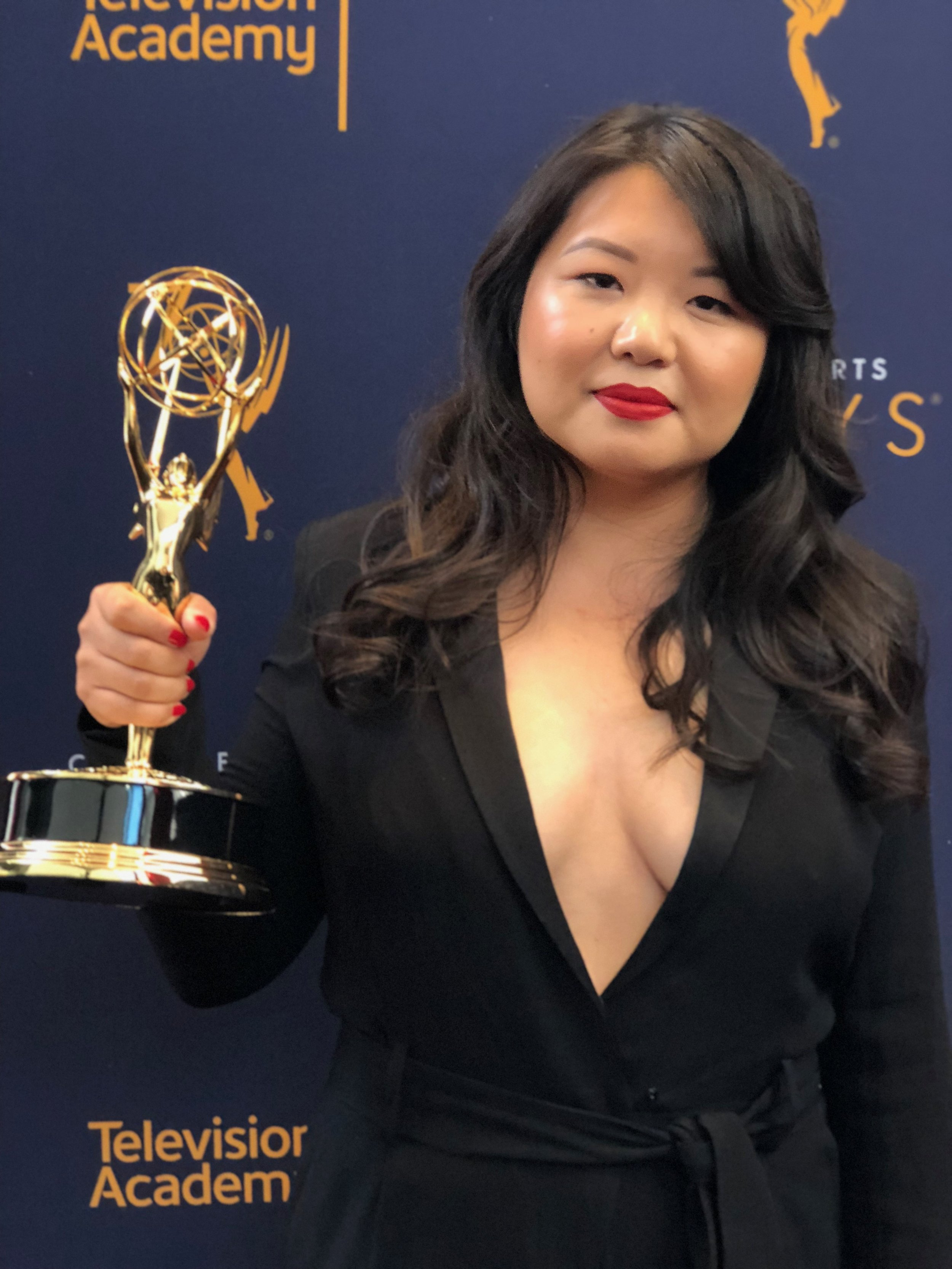 """Jessica Gao - Jessica Gao is a Los Angeles-based screenwriter. She was born in Beijing and raised in the San Gabriel Valley, a suburb of LA. She has written for Rick & Morty, Silicon Valley, Corporate, and Robot Chicken. She co-hosts """"Whiting Wongs,"""" a podcast about race and writing with Dan Harmon. She recently won an Emmy Award for her work on"""