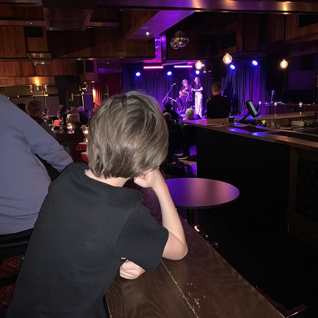 "My gorgeous Godson Chet watching us last night, on a break from helping his mum sell the merch! @formanism and Nashy became besties! Merch area was gold and a ""Ta Da""to top it off! Great fun had by all! Thank you Doug Nixon for flying down and sorting stuff out for us! ❤️ @amberdwilkinson and Mick for EVERYTHING!! Thanks @thefyrefly for such a great night and Rob Hornbuckle for fabulous sound and staff, big love to you all ❤️❤️❤️"
